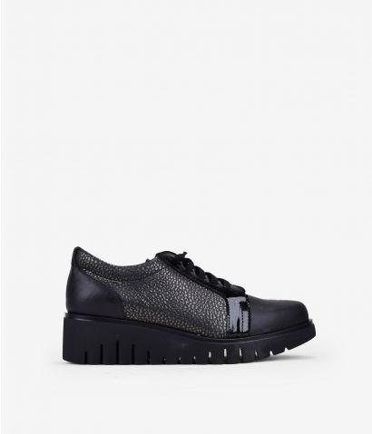 Zapatillas negras piel