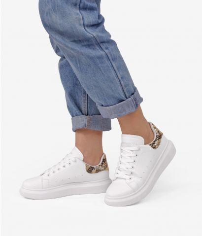 Zapatillas blancas con serpiente
